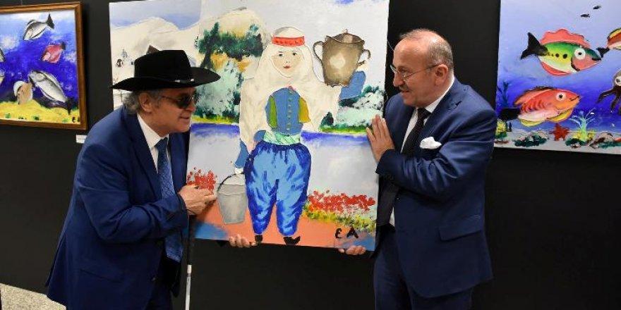 Ama olan ressam Eşref Armağan'ın resimdeki müthiş başarısı