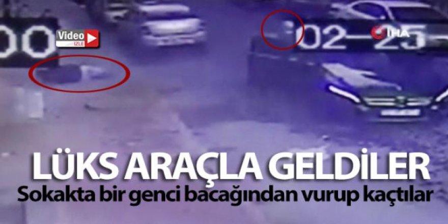 Lüks araçla geldiler, sokakta bir genci bacağından vurup kaçtılar